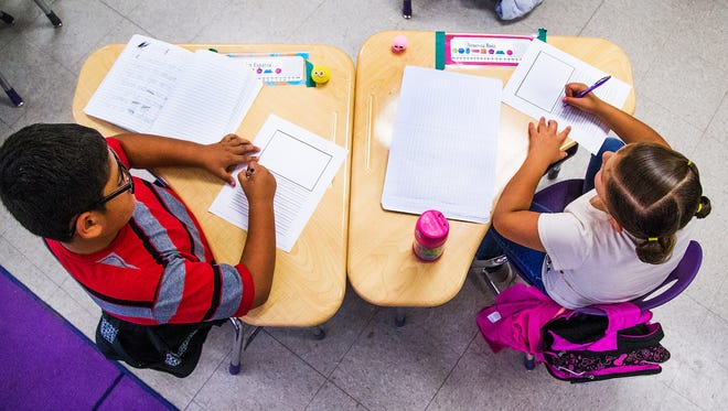 Kindergarten students do their work in class at the Gila Bend Elementary School Thursday, April 20, 2017.