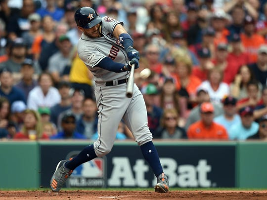 Houston Astros shortstop Carlos Correa hits a two run home run during the first inning against the Boston Red Sox in game three of the 2017 ALDS at Fenway Park.