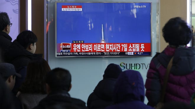 South Koreans watch a TV news program with a file footage about North Korea's rocket launch at Seoul Railway Station in Seoul, South Korea, Sunday, Feb. 7, 2016. North Korea on Sunday defied international warnings and launched a long-range rocket that the United Nations and others call a cover for a banned test of technology for a missile that could strike the U.S. mainland.