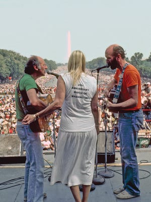 "Peter, Paul and Mary perform on the National Mall in Washington, D.C., for the 20th anniversary of the March on Washington and Martin Luther King's  ""I Have a Dream"" speech there on Aug. 28, 1963."