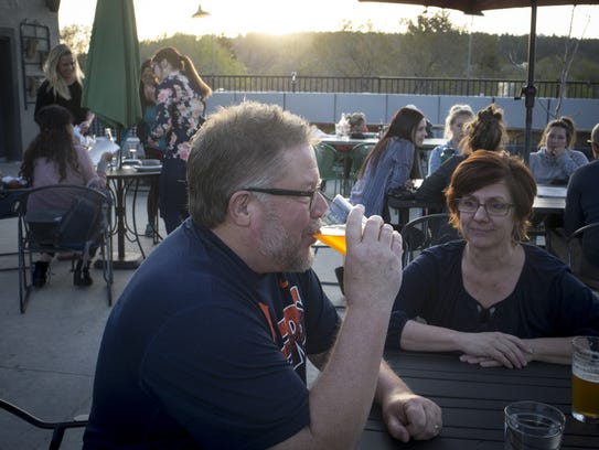 Gary and Cheryl Hope enjoy an evening on the Root Public