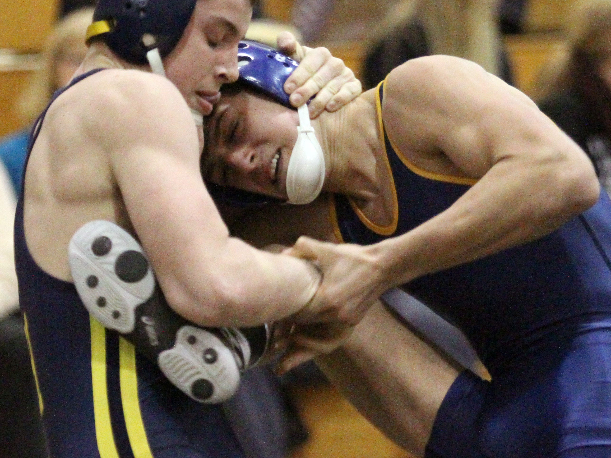 Hartland's Nick DiNoble, left, beat Clarkston's Jake Calvano by an 8-2 decision at 140 pounds in Wednesday's regional semifinals.