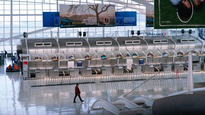 A man walks past the closed Air France counters at the Terminal 1 section at John F. Kennedy International Airport on March 12, 2020 in New York City. - US President Donald Trump announced a shock 30-day ban on travel from mainland Europe over the coronavirus pandemic that has sparked unprecedented lockdowns, widespread panic and another financial market meltdown Thursday.The announcement came as China, where the outbreak that first emerged in December, showed a dramatic drop in new cases and claimed