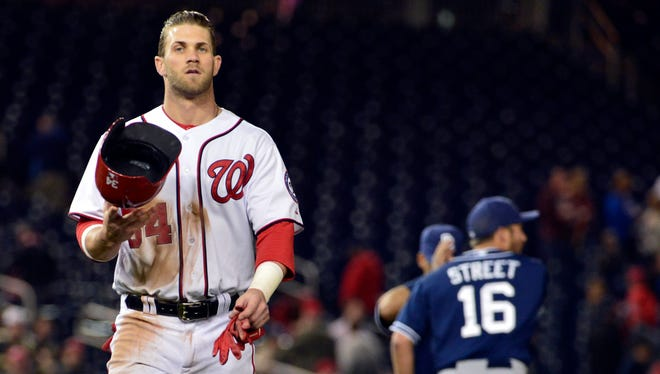 Washington Nationals left fielder Bryce Harper walks off the field after being thrown out at second base in the twelfth inning to end the game against the San Diego Padres at Nationals Park.