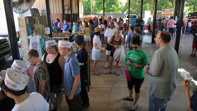 In this file photo, gatherers are seen in 2015, at the Downtown Wichita Falls Farmers Market at Eighth and Ohio during the Krispy Kreme Pop-Up event. The area is becoming a gathering place for people looking for fresh, area produce as well as other items from a variety of vendors. Wichita Falls was in the top 10 for cities in the U.S. that are best to retire early.
