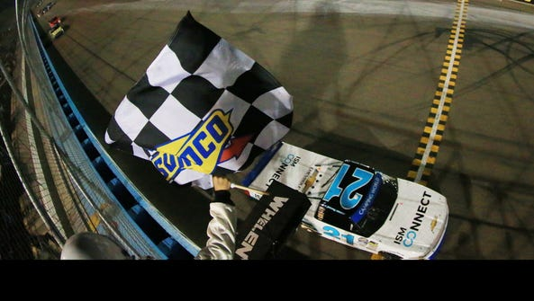 Johnny Sauter takes the checkered flag to win the NASCAR