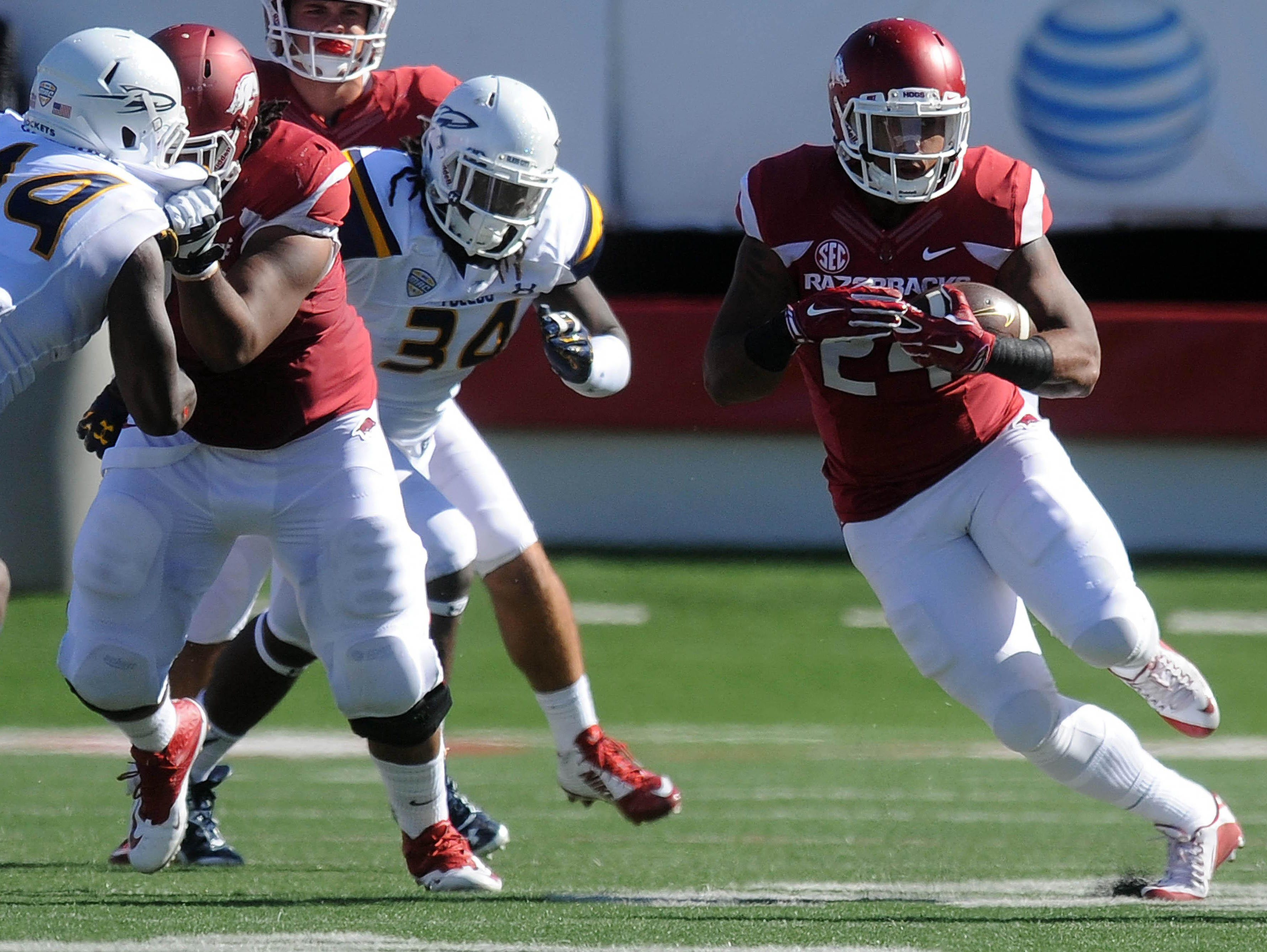The Razorbacks' Kody Walker (24) has been given just 10 rushes this season for 28 total yards.