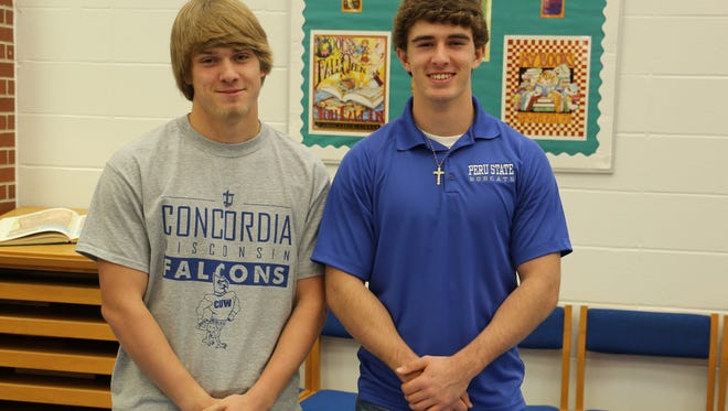 West Ouachita's Jacob Holloway (left) and Hunter Chatham will continue their football careers in college.