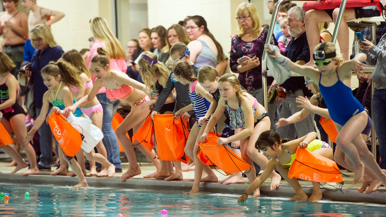 Laney Yard, 9, takes viewers underwater during the underwater egg hunt at the Hanover YMCA.