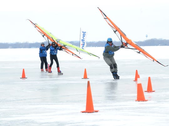 Three wing class racers round the final turn before the finish line during a short track slalom race at a previous sturgeon event.