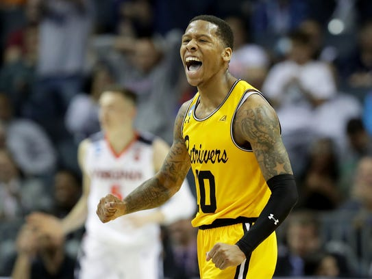Jairus Lyles of the UMBC Retrievers reacts after a