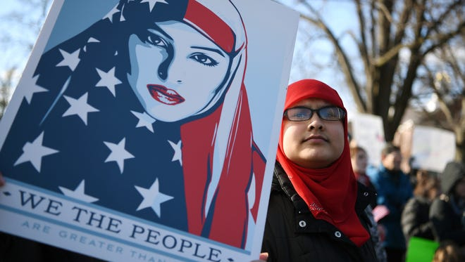 Teaneck --- Sunday, January 29, 2017 -- Teaneck Together organized a rally  showing Teaneck will stand together in solidarity with Muslims and immigrants of all nationalities in the community against the ban on immigration signed by President Trump. The rally was held on the Municipal green in Teaneck on Sunday, January 29, 2017.