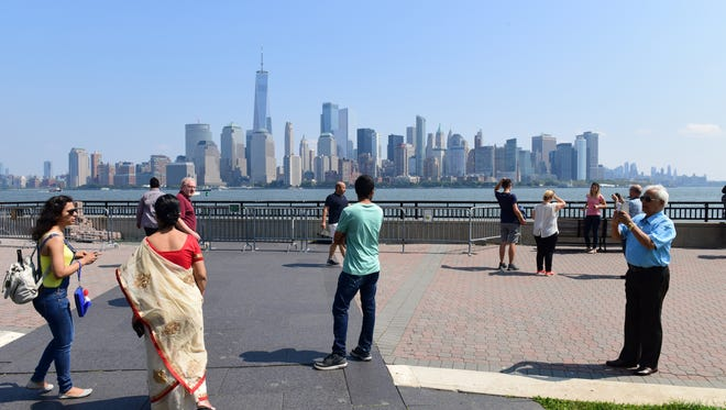 A view from the waterfront at Liberty State Park, looking across the Hudson River to lower Manhattan and the new World Trade Center tower.