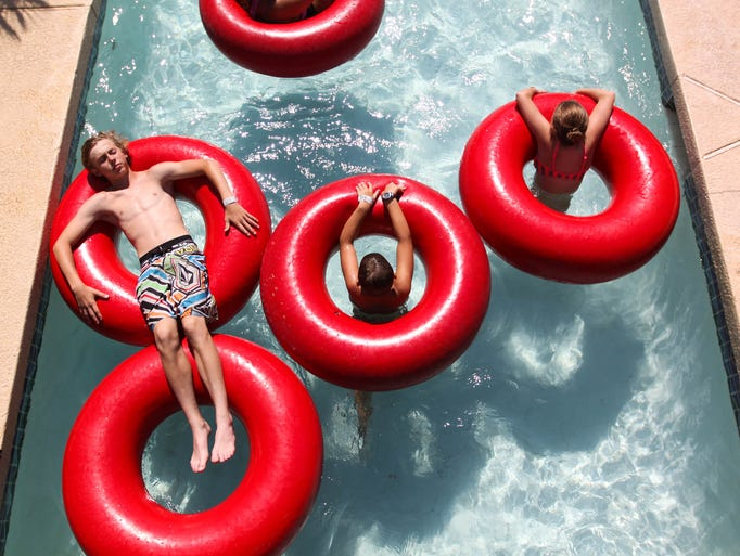 Kids float down the lazy river at Golfland Sunsplash