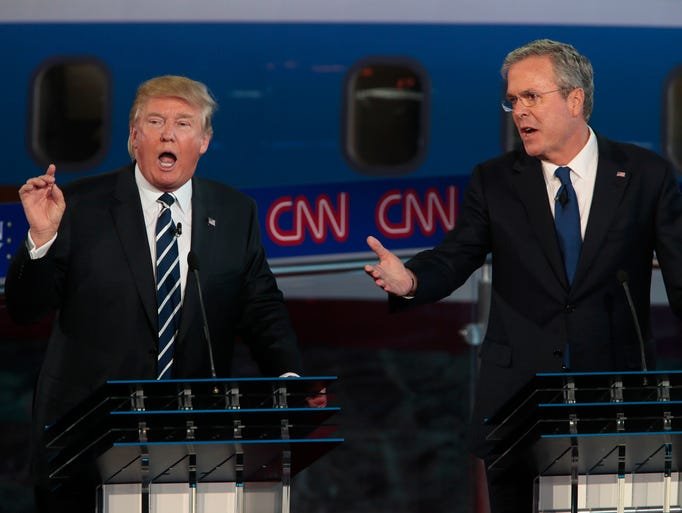 Republican presidential candidates Donald Trump, left,