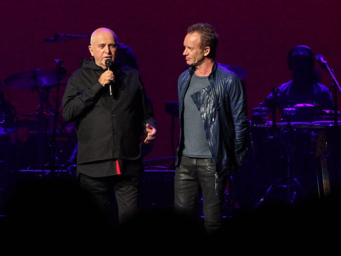 Peter Gabriel, left, and Sting, right, greet the crowd