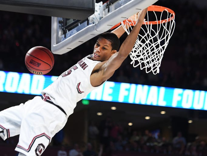 South Carolina guard PJ Dozier (15) makes a dunk during