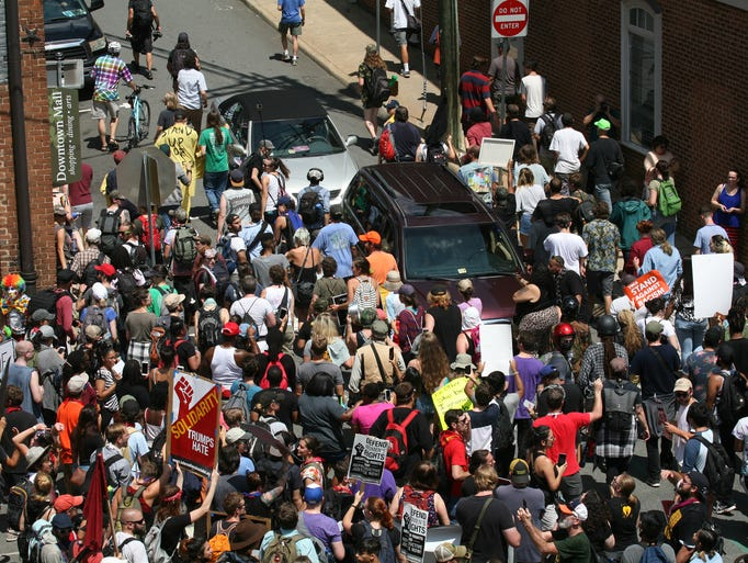 Protesters block the intersection of 4th and Water