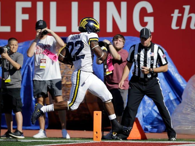 Michigan running back Karan Higdon (22) scores on the