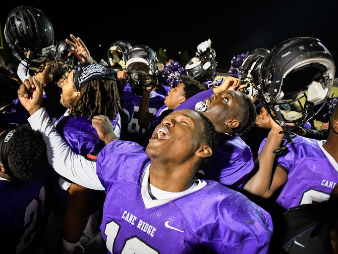 Cane Ridge's Theo Chisom (10) celebrates after their