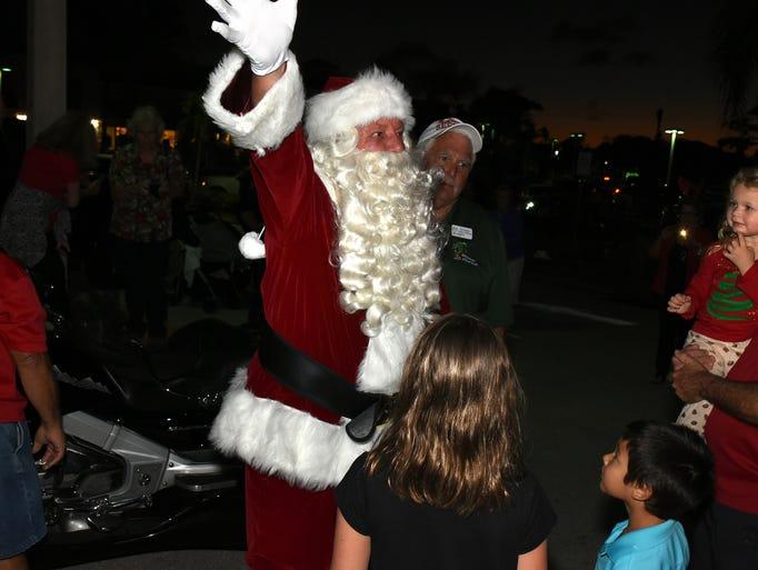 Santa greets his public, including Abigail Kuhn, 2.