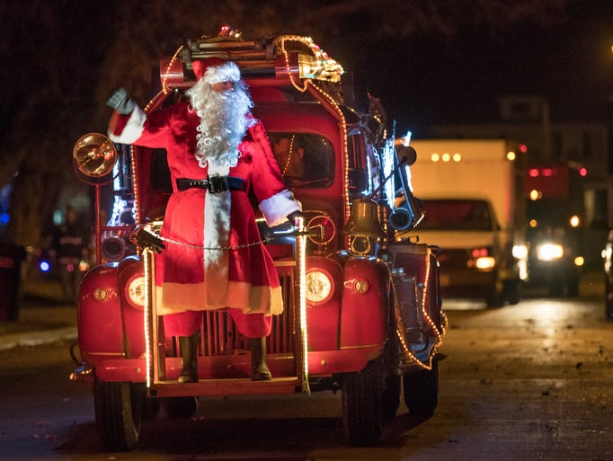 Santa waves to east side residents. The 18th Annual