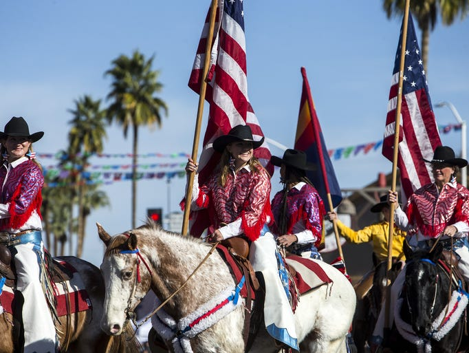 Parade participants on horseback are pictured during