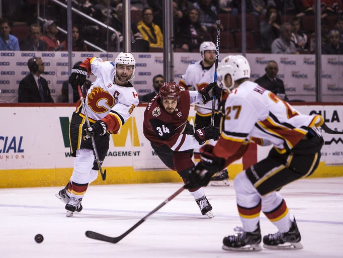 Coyotes center Zac Rinaldo chases the puck against