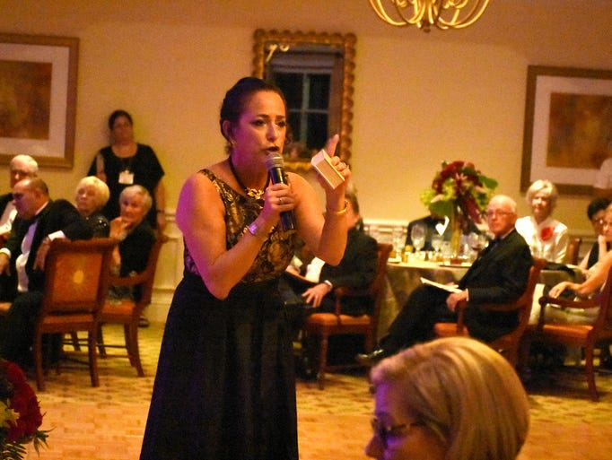 Arts Center executive director Hyla Crane addresses