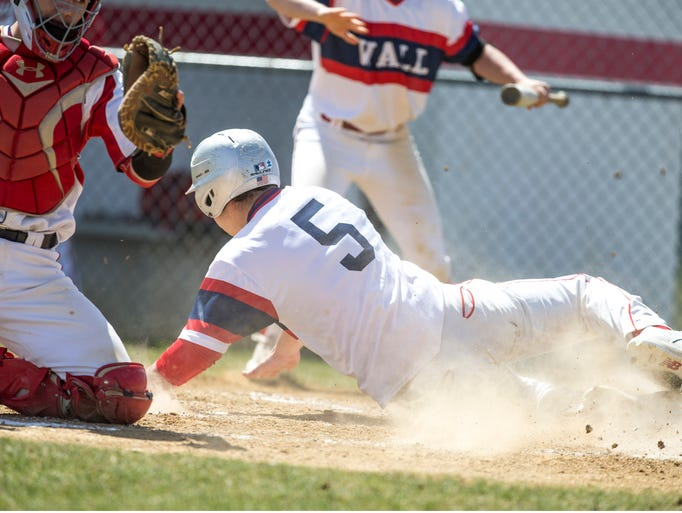 Wall Township's Grant Shulman slides in safe at home