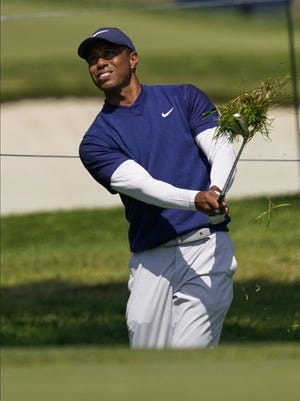 Tiger Woods hits from the rough on the seventh hole Saturday during the third round of the PGA Championship.