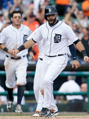 Alex Avila celebrates after scoring on a bases-loaded walk by Miguel Cabrera in the 11th inning to lift the Tigers past the Blue Jays, 6-5, at Comerica Park on July 16, 2017.