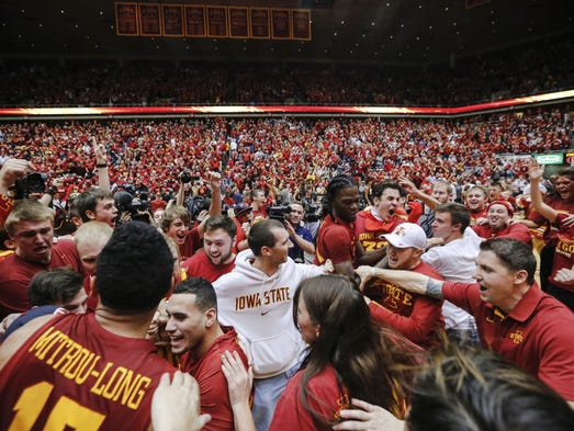 Fans rush the court as Iowa State celebrates a 83-82