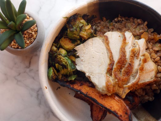 Herb roasted chicken with toasted faro, brussel sprouts,