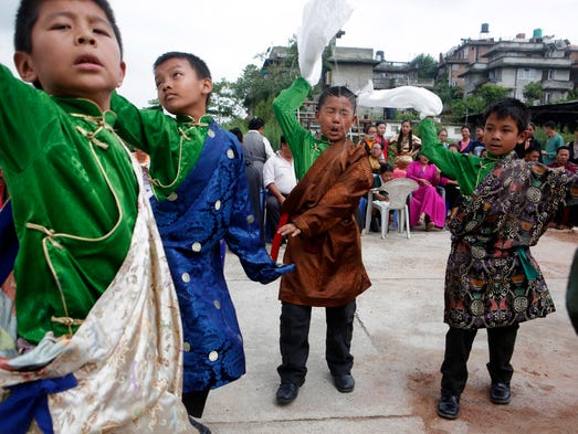 Tibetan boys dance during celebrations to mark the