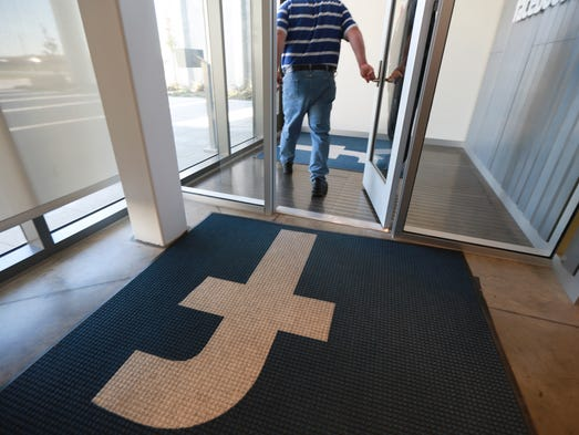 A man walks out of the new Facebook data centers on