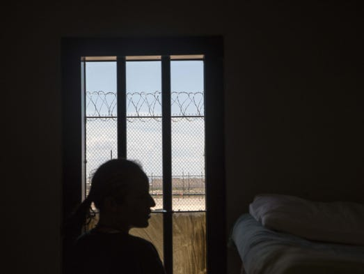 A woman in her room at the Eloy Detention Center