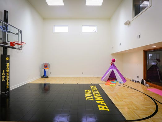 Urbandale home is hawkeye fans 39 heaven for Built in basketball court