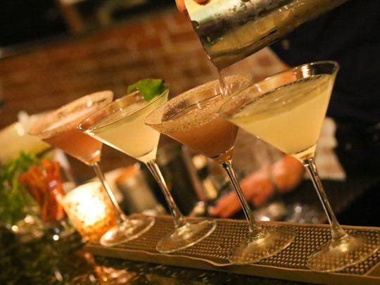 Alex McCarthy, who tends bar and co-manages Maven, makes an assortment of martinis including lavendar and basil-infused martinis.