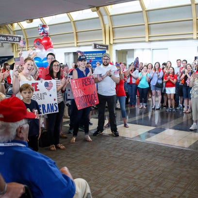 A Stars and Stripes Honor Flight veteran enjoying a warm welcome to Washington D.C. after a spring 2016 flight.