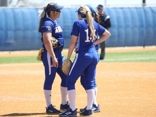 Angelo State pitcher Brandy Marlett (left) has a discussion with infielders Jade Strother (15) and Bailey Wallace during a Lone Star Conference softball doubleheader against Tarleton State at Mayer Field on Friday, March 30, 2018.
