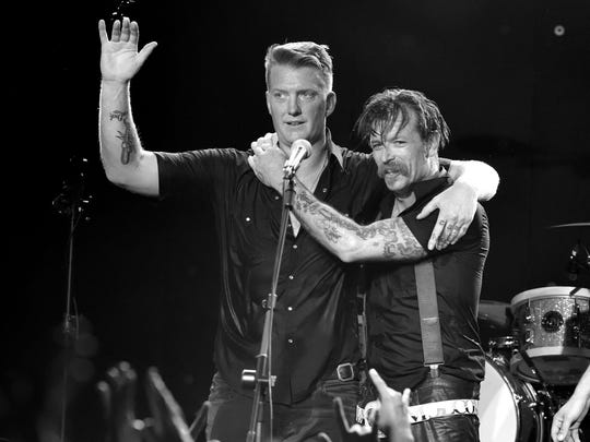 Musicians Josh Homme (L) and Jesse Hughes of Eagles