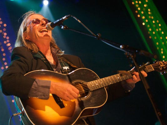 636062669147052397-Dougie-MacLean-smiling-on-stage-square-2014.jpg