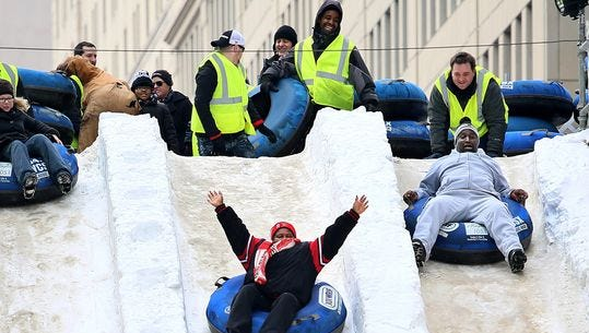 People brave the snow slide during the 2015 Winter Blast in Campus Martius Park in downtown Detroit.