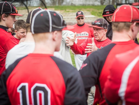 Wapahani coach Brian Dudley talks with players after