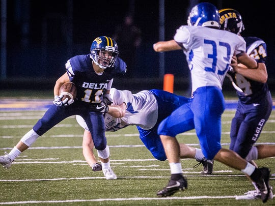 Delta's Cameron Levers fights past Centerville's defense