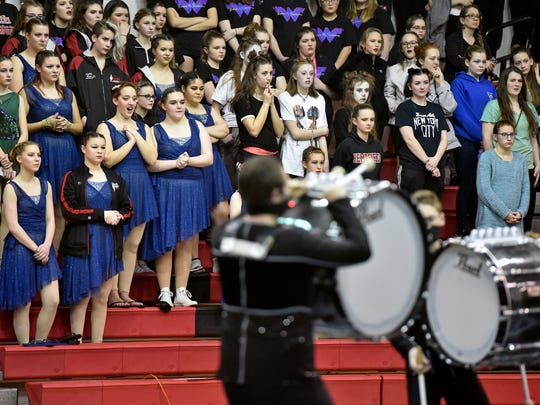 "Visiting color guard members watch as the Susquehannock High School Percussion Ensemble perform their show ""The Human Element"" during a Keystone Indoor Drill Association Percussion & Color Guard Indoor Competition Saturday, Feb. 17, 2018, at Susquehannock High School. The competition's lineup originally featured 38 units, but 13 had to drop out when the event was moved up several hours in anticipation of the afternoon winter weather advisory."