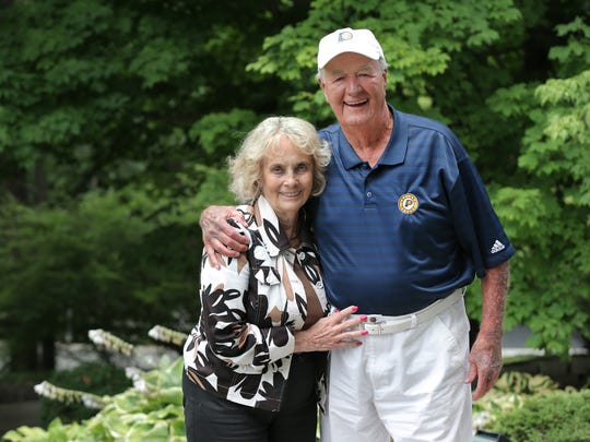 Bobby and Nancy Leonard pose for a portrait at their home in Carmel, Ind. He's currently in a rehab center with a shattered wrist.