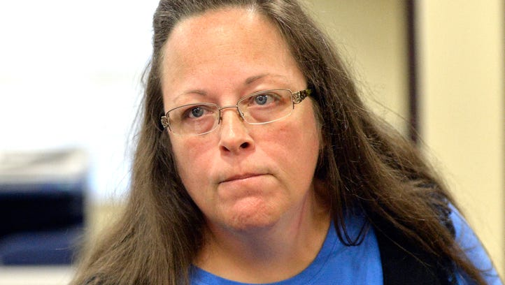 Rowan County Clerk Kim Davis listens to a customer