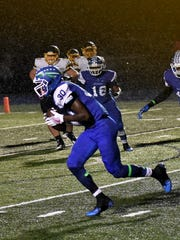 "Gianni Gamble (30) of Winton Woods takes a ""pick six"""